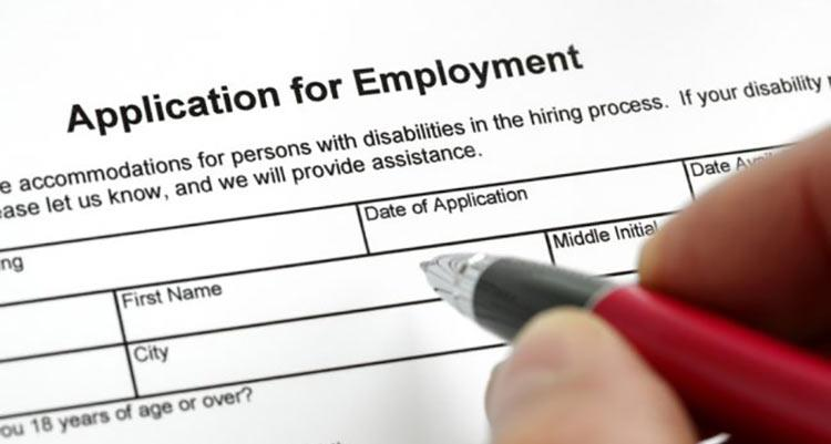 Filling out application for employment