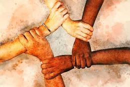 Diverse hands holding wrists forming circle